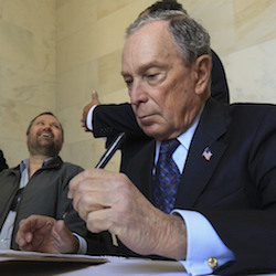 Former New York City Mayor Michael Bloomberg fills out paperwork, Tuesday, Nov. 12, 2019, at the state Capitol in Little Rock, Ark., to appear on the ballot in Arkansas' March 3 presidential primary. Bloomberg hasn't formally announced a bid for the Democratic presidential nomination, but his trip to Arkansas is the latest indication that he is leaning toward a run. (Staton Breidenthal/The Arkansas Democrat-Gazette via AP)