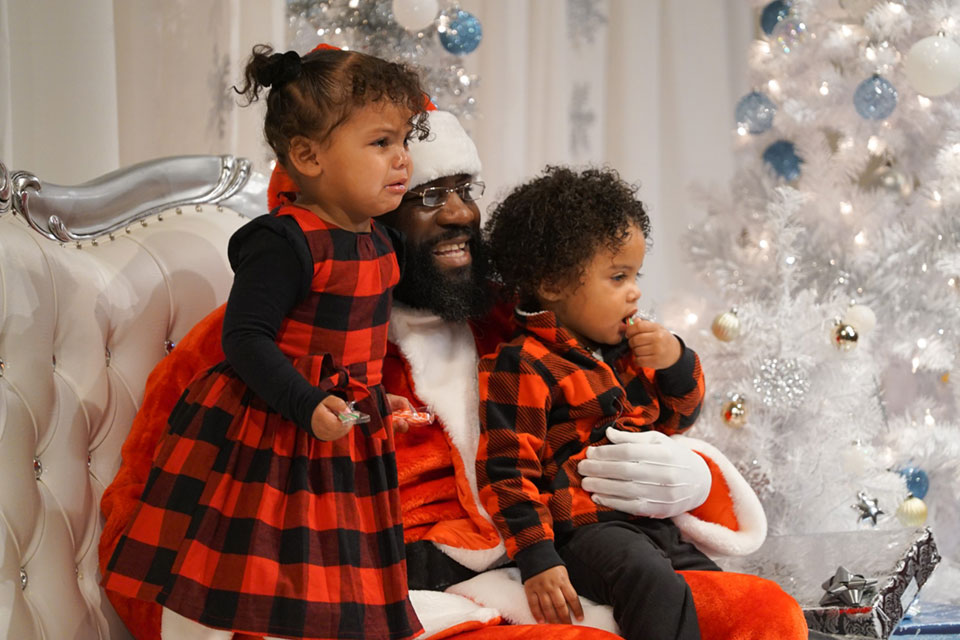 Kaidence, 2 and Ameir, 1 have their picture taken with Santa during the annual visit by Black Santa to the Northwest African American Museum in Seattle on Saturday, December 7, 2019.  Families came from as far away as Tacoma to visit with Santa and get their pictures taken. The children could also decorate cookies, make decorations and write letters to Santa