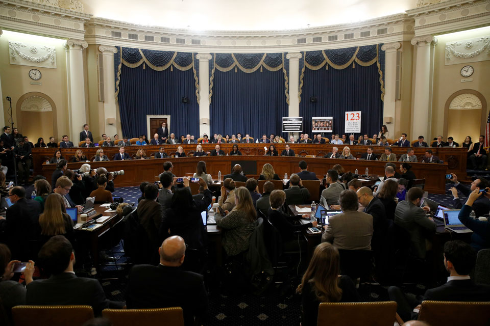 Members of the committee work during a House Judiciary Committee markup of the articles of impeachment against President Donald Trump, Friday, Dec. 13, 2019, on Capitol Hill in Washington. Trump impeachment goes to full House after Judiciary panel approves charges of abuse of power, obstruction of Congress. (AP Photo/Patrick Semansky, Pool)