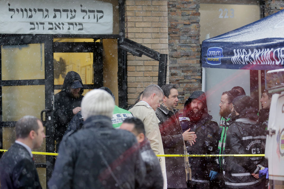 Jersey City's mayor Steven Fulop, center right, talks with first responders at the scene of a shooting in Jersey City, N.J., Wednesday, Dec. 11, 2019. Fulop says gunmen targeted a kosher market during a shooting that killed multiple people Tuesday