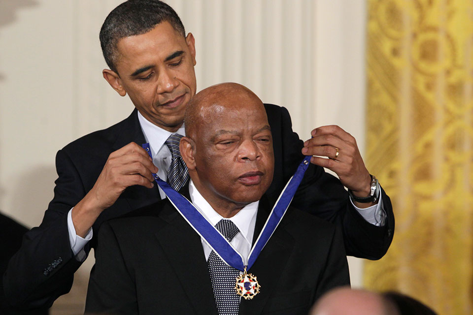 In this Feb. 15, 2011, file photo, President Barack Obama presents a 2010 Presidential Medal of Freedom to Rep. John Lewis, D-Ga., during a ceremony in the East Room of the White House in Washington