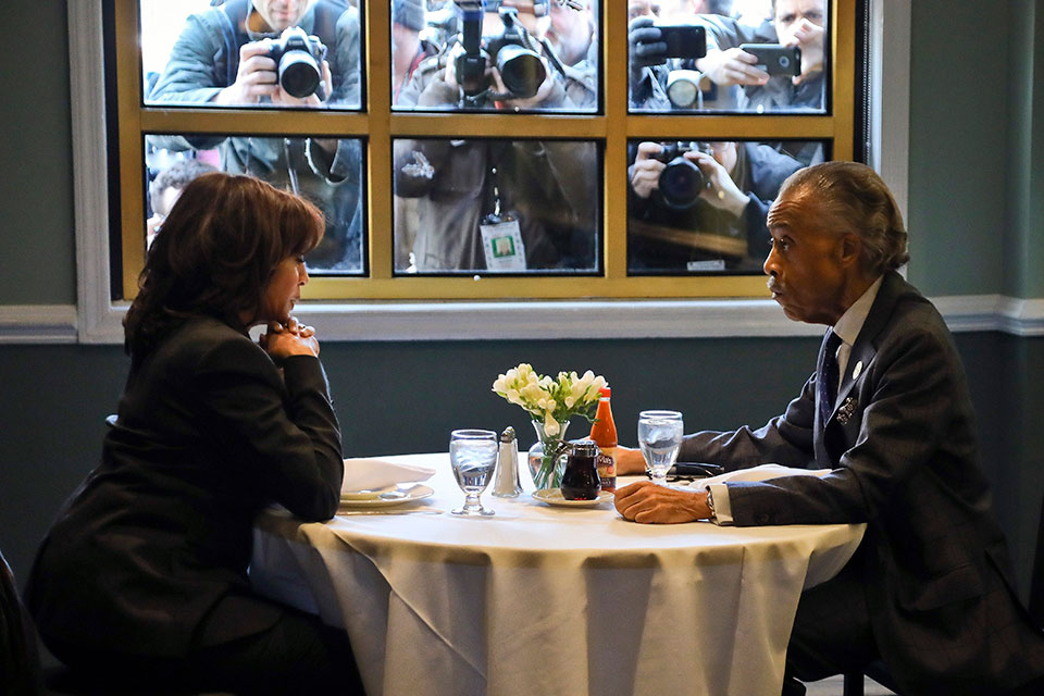 Sen. Kamala Harris, D-Calif., meets with civil rights leader Rev. Al Sharpton, president of the National Action Network, during lunch at Sylvia's Restaurant in the Harlem neighborhood of New York on Feb. 21, 2019