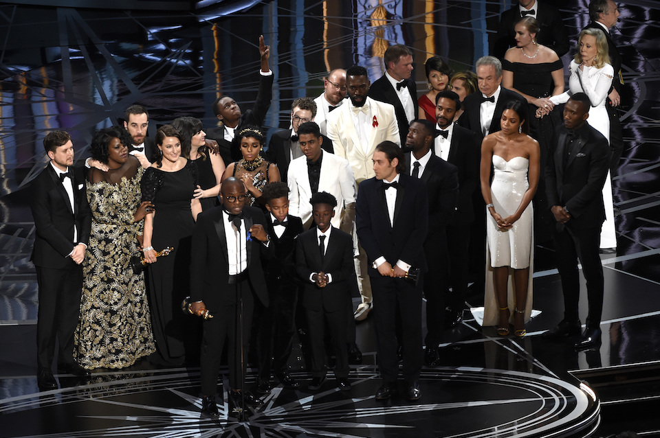 "Barry Jenkins and the cast and crew of ""Moonlight"" accept the award for best picture at the Oscars in Los Angeles, Feb. 26, 2017. (Photo by Chris Pizzello/Invision/AP, File)"