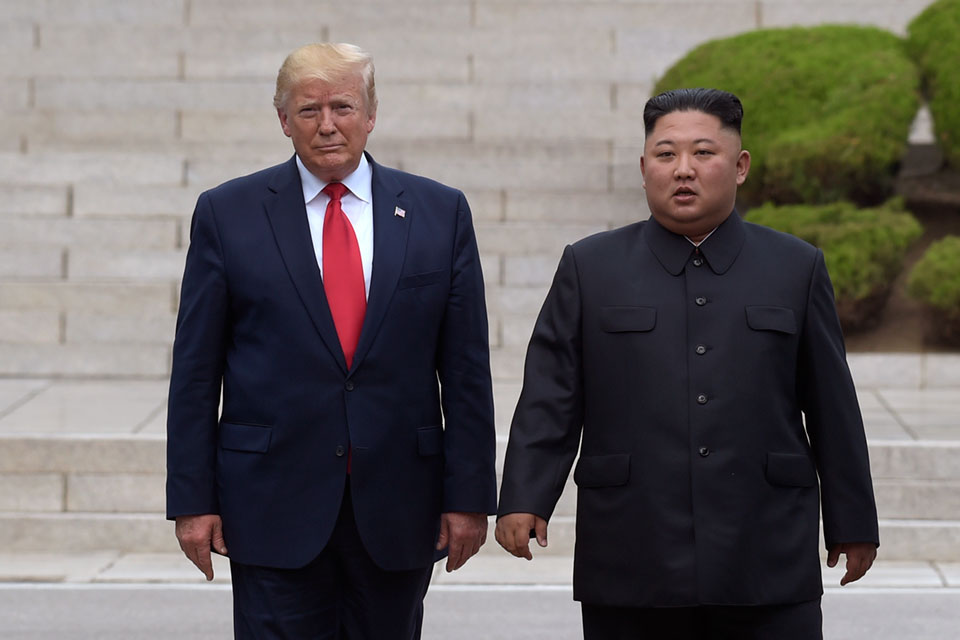 In this June 30, 2019, file photo, President Donald Trump, left, meets with North Korean leader Kim Jong Un