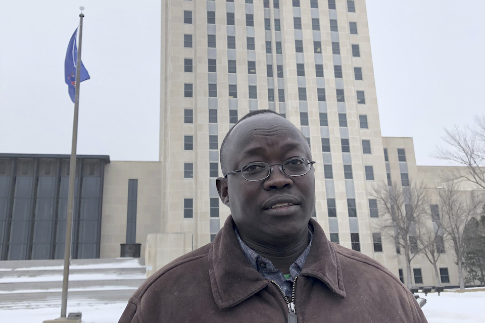 Reuben Panchol is shown Friday, Dec. 6, 2019 at the North Dakota state capitol in Bismarck. Panchol, who immigrated from Sudan to North Dakota as a child, says he hopes to tell his personal story at a meeting Monday, Dec. 9 at which the Burleigh County Commission may vote against accepting any new refugees. It's believed the county would be the first to do so since President Donald Trump's executive order earlier this fall gave states and counties the ability to do so. (AP Photo/James MacPherson)