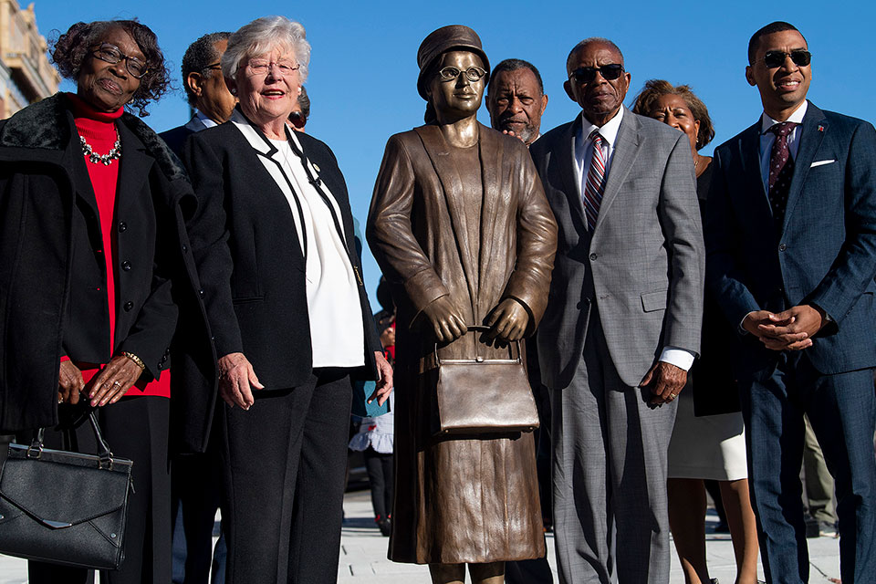 Mary Louise Smith, from left, Gov. Kay Ivey, Civil Rights Attorney Fred Gtray and Montgomery Mayor Steven Reed pose after the unveiling of the Rosa Parks statue in downtown Montgomery, Ala., Sunday, Dec. 1, 2019