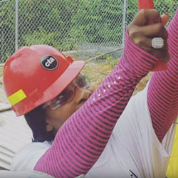 Serena Williams in construction hat building in Jamaica