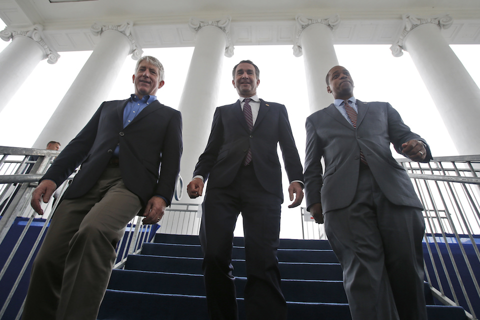 Virginia Gov.-elect, Lt. Gov Ralph Northam, center, walks down the reviewing stand with Lt. Gov-elect, Justin Fairfax, right, and Attorney General Mark Herring at the Capitol in Richmond, Va., Jan. 12, 2018. The political crisis in Virginia exploded Wednesday, Feb. 6, 2019, when the state's attorney general confessed to putting on blackface in the 1980s and a woman went public with detailed allegations of sexual assault against the lieutenant governor. With Northam's career already hanging by a thread over a racist photo, the day's developments threatened to take down all three of Virginia's top elected officials. (AP Photo/Steve Helber, File)