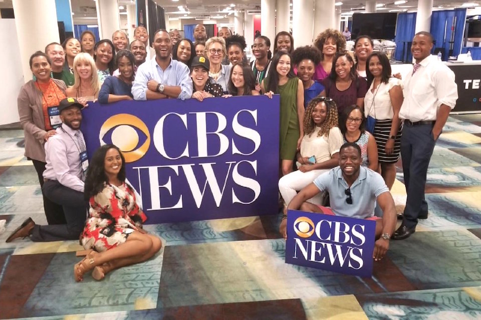 Black journalists pose with other guests with CBS news poster boards at the National Association of Black Journalists' annual Convention and Career Fair last August in Detroit.
