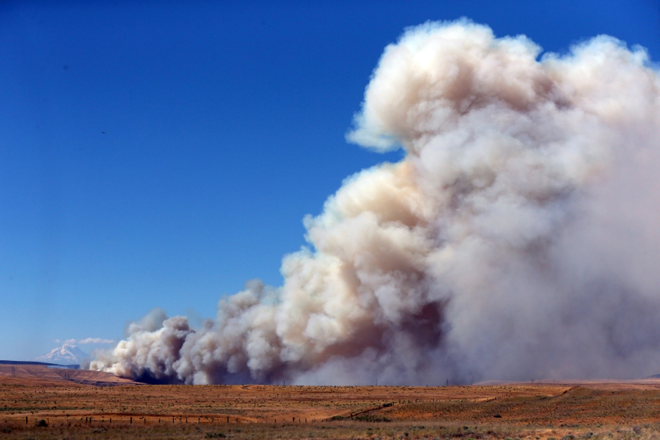 In this July 18, 2018, file photo, smoke from a wildfire spreads over Wasco County southeast of The Dalles, Ore. The Oregon Environmental Quality Commission approved new smoke rules Thursday, Jan. 24, 2019, for the state that will allow more planned burns that reduce wildfire risk by getting rid of underbrush and dead trees. (Mark Graves/The Oregonian via AP, file)