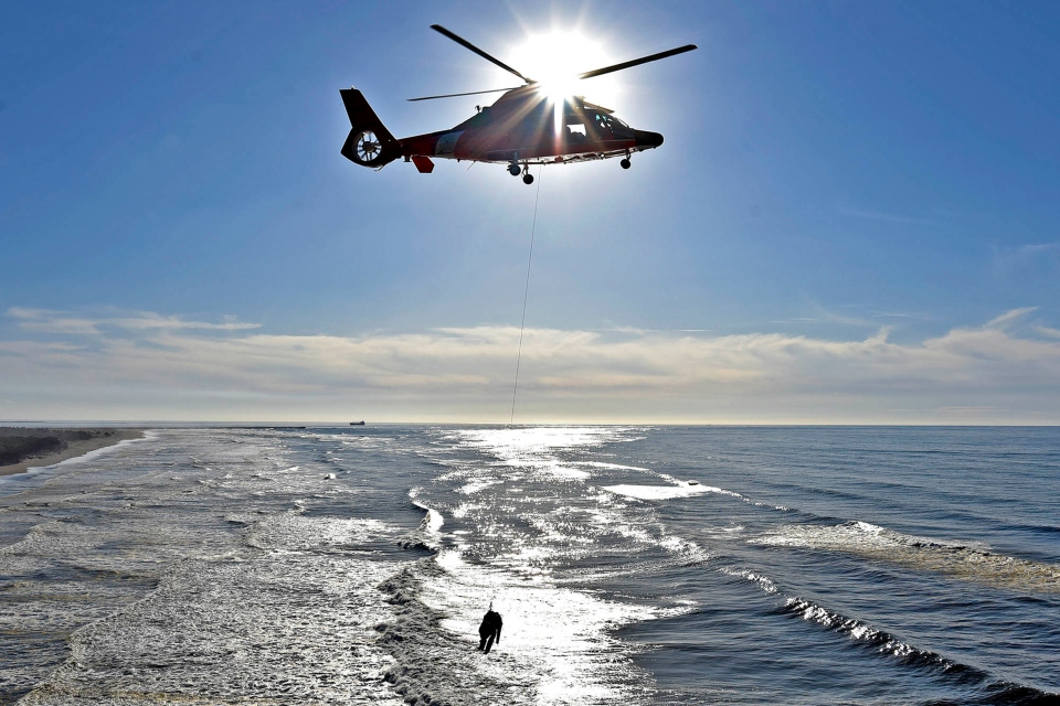 In this Nov. 7, 2018 file photo, Coast Guard personnel from Air Station Astoria in Oregon participate in a rescue exercise near Cape Disappointment, Wash. Anticipating possible additional federal government shutdowns, Oregon's Senate president has prepared a bill that will allow federal employees who are working but not being paid to receive unemployment benefits. The draft of the bill also would allow a state-funded program to pay unemployment benefits to active duty U.S. Coast Guard personnel stationed in Oregon who are legally compelled to provide regular service without compensation during a shutdown. (Colin Murphey/The Daily Astorian via AP)