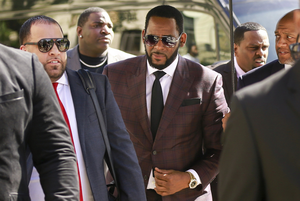 R&B singer R. Kelly, center, arrives at the Leighton Criminal Court building for an arraignment on sex-related felonies in Chicago, June 26, 2019. Already facing sexual abuse charges brought by Illinois prosecutors, R. Kelly was arrested in Chicago Thursday, July 11, 2019 on a federal grand jury indictment listing 13 counts including sex crimes and obstruction of justice. (AP Photo/Amr Alfiky, File)