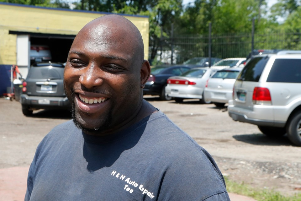 In this July 23, 2019, photo, auto repairman Terrance Holmes is interviewed in Detroit. When Barack Obama was on the ballot in 2008 and 2012, there was no question that Holmes would vote for the first black president. But as he helped fix cars at a repair shop on Detroit's west side, he recalled his ambivalence about the 2016 campaign. He hasn't paid much attention to the early Democratic primary and didn't know that two high-profile black candidates are running. But he vowed to help vote President Donald Trump out of office in 2020, regardless of which Democrat emerges as his challenger. (AP Photo/Carlos Osorio)