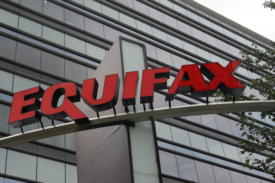 FILE - This July 21, 2012, file photo shows signage at the corporate headquarters of Equifax Inc., in Atlanta. Equifax will pay up to $700 million to settle with the Federal Trade Commission and others over a 2017 data breach that exposed Social Security numbers and other private information of nearly 150 million people. The proposed settlement with the Consumer Financial Protection Bureau, if approved by the federal district court Northern District of Georgia, will provide up to $425 million in monetary relief to consumers, a $100 million civil money penalty, and other relief. (AP Photo/Mike Stewart, File)