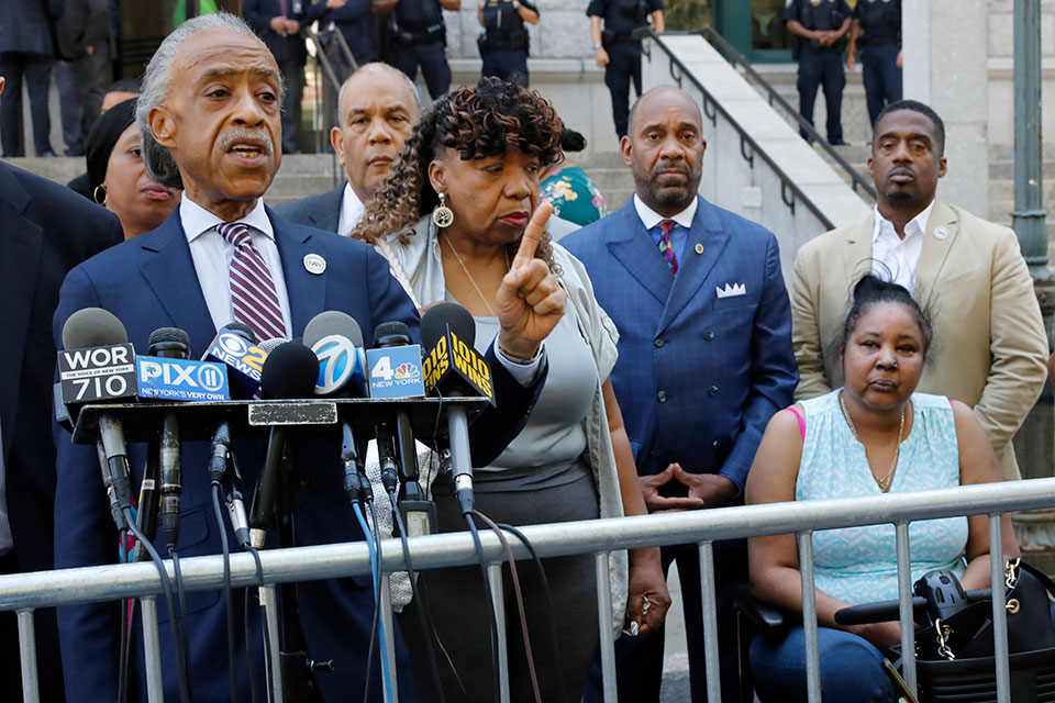 Rev. Al Sharpton, speaks at a news conference outside the U.S. Attorney's office, in Brooklyn, Tuesday, July 16, 2019. Gwen Carr, mother of chokehold victim Eric Garner is at center, and his widow Esaw Snipes is at right