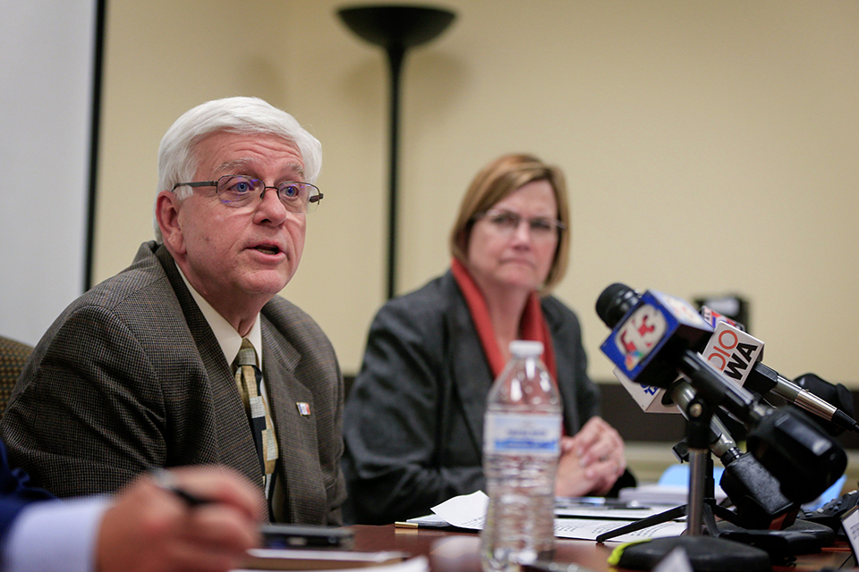 In this Oct. 31, 2017 photo, Iowa Department of Human Services Director Jerry Foxhoven announces that AmeriHealth Caritas will pull out of Iowa Medicaid management in Des Moines, Iowa. Foxhoven had an obsession with the late rapper Tupac Shakur during the 2-year tenure before the governor requested his resignation in June 2019. (Zach Boyden-Holmes/The Des Moines Register via AP)