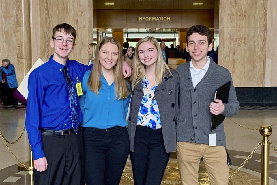 "Sam Adamson, Lori Riddle, Hailey Hardcastle, and Derek Evans pose at the Oregon State Capitol in Salem, Ore. Feb. 6, 2019. The teens introduced legislation to allow students to take ""mental health days"" as they would sick days in an attempt to respond to a mental health crisis gripping the state. (Jessica Adamson/Providence Health & Services via AP)"