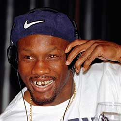 In this April 9, 1997, file photo, WBC welterweight champion Pernell Whitaker adjusts his head phones during a news conference in Las Vegas.