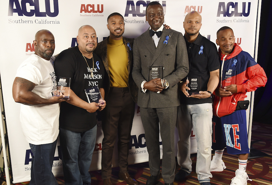 Presenter Michael B. Jordan, third from left, poses with, from left, honorees Antron McCray, Raymond Santana, Yusef Salaam, Kevin Richardson and Korey Wise at the ACLU SoCal's 25th Annual Luncheon at the JW Marriott at LA Live, Friday, June 7, 2019, in Los Angeles. (Photo by Chris Pizzello/Invision/AP)