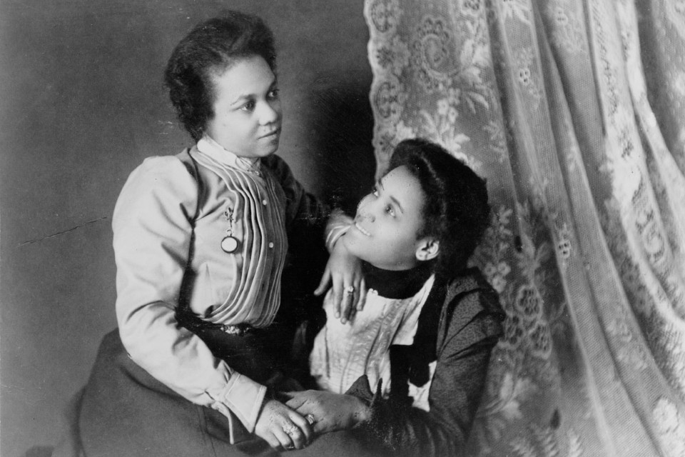 Two African American women, three-quarter length portrait, seated, facing each other (1899 or 1900), part of W. E. B. Du Bois's albums of photographs exhibited at the Paris Exposition Universelle in 1900, v. 1, no. 48. Library of Congress Prints and Photographs Division.