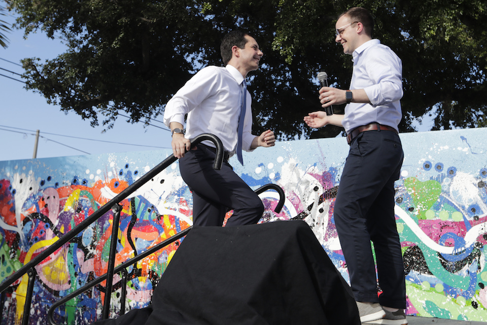 Democratic presidential candidate Pete Buttigieg, the mayor of South Bend, Ind., left, is introduced by his husband Chasten Buttigieg, right, during a fundraiser at the Wynwood Walls, in Miami, May 20, 2019. Buttigieg knows firsthand the burden of six-figure student loan debt. He and his husband have loans of more than $130,000, placing them in the ranks of the 43 million Americans who owe federal student debt.(AP Photo/Lynne Sladky, File)