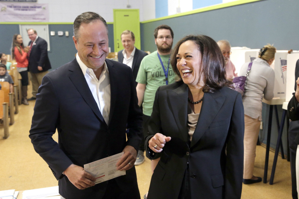 FILE - In this Nov. 8, 2016, file photo, Kamala Harris, right, votes with her husband, Douglas Emhoff in Los Angeles. Emhoff is playing an increasingly public role in the campaign of his wife. He'll make his first solo appearance of the campaign on Saturday, June 8, 2019. (AP Photo/Nick Ut, File)