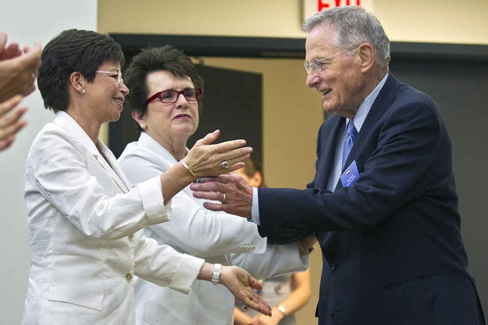 "In this June 20, 2012 file photo, former Sen. Birch Bayh, D-Ind., the author of Title IX in Congress, is applauded by Senior Adviser to the President and Chair of the Council on Women and Girls Valerie Jarrett, left, and tennis great Billie Jean King, center during a forum in the South Court Auditorium at the White House in Washington in a gathering to celebrate the 40th anniversary of Title IX. Bayh, who championed the federal law banning discrimination against women in college admissions and sports, died from pneumonia at his home in Easton, Md., Thursday, March 14, 2019, at age 91. King, who worked with Bayh on women's rights issues, released a statement with his family Thursday saying the former senator was ""one of the most important Americans of the 20th century."" (AP Photo/Manuel Balce Ceneta, File)"