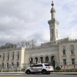 A police vehicle is parked outside the Islamic Center of Washington, Friday, March 15, 2019 in Washington. (AP Photo/Susan Walsh)