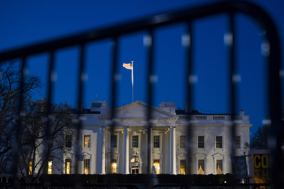 The White House is seen through a security fence, before sunrise, in Washington, Saturday, March 23, 2019. Special counsel Robert Mueller closed his long and contentious Russia investigation with no new charges, ending the probe that has cast a dark shadow over Donald Trump's presidency. (AP Photo/Cliff Owen)