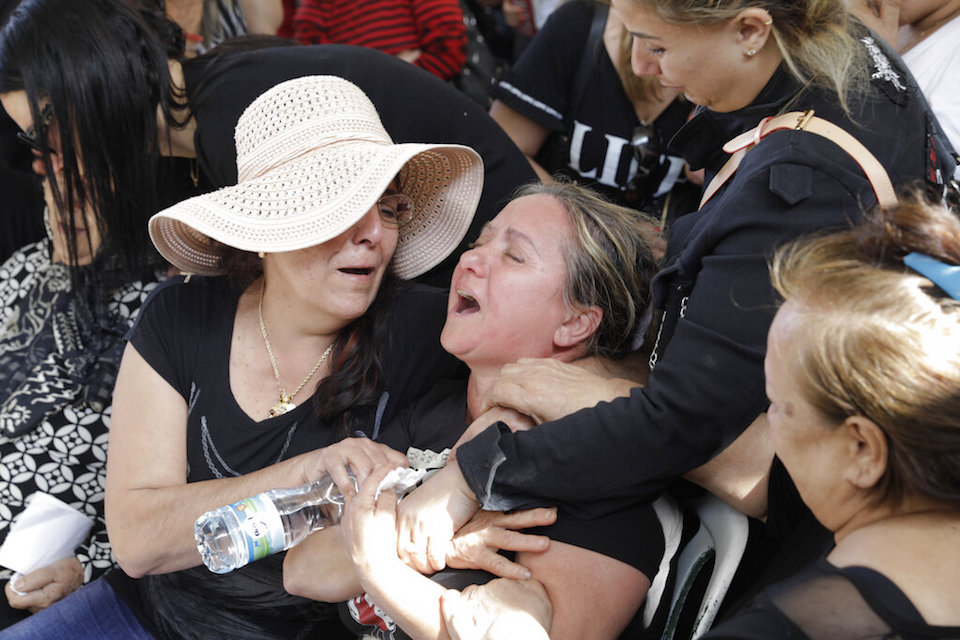 Relatives cry during the funeral of Moshe Agadi in the city of Ashkelon, Israel, Sunday.May 5, 2019. Agadi was killed outside his home in Ashkelon by a rocket fired from Gaza Strip. (AP Photo/Sebastian Scheiner)