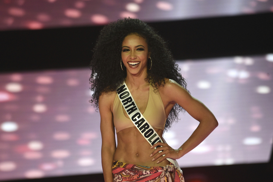Miss North Carolina Cheslie Kryst wins the 2019 Miss USA final competition in the Grand Theatre in the Grand Sierra Resort in Reno, Nev., Thursday, May 2, 2019. Three black women are the reigning Miss USA, Miss Teen USA and Miss America. Chelsie Kryst completed the historic triple on Thursday, May 2, 2019 beside pageant winners 2019 Miss America Nia Franklin and recently crowned 2019 Miss Teen USA Kaliegh Garris. (Jason Bean/The Reno Gazette-Journal via AP, File)