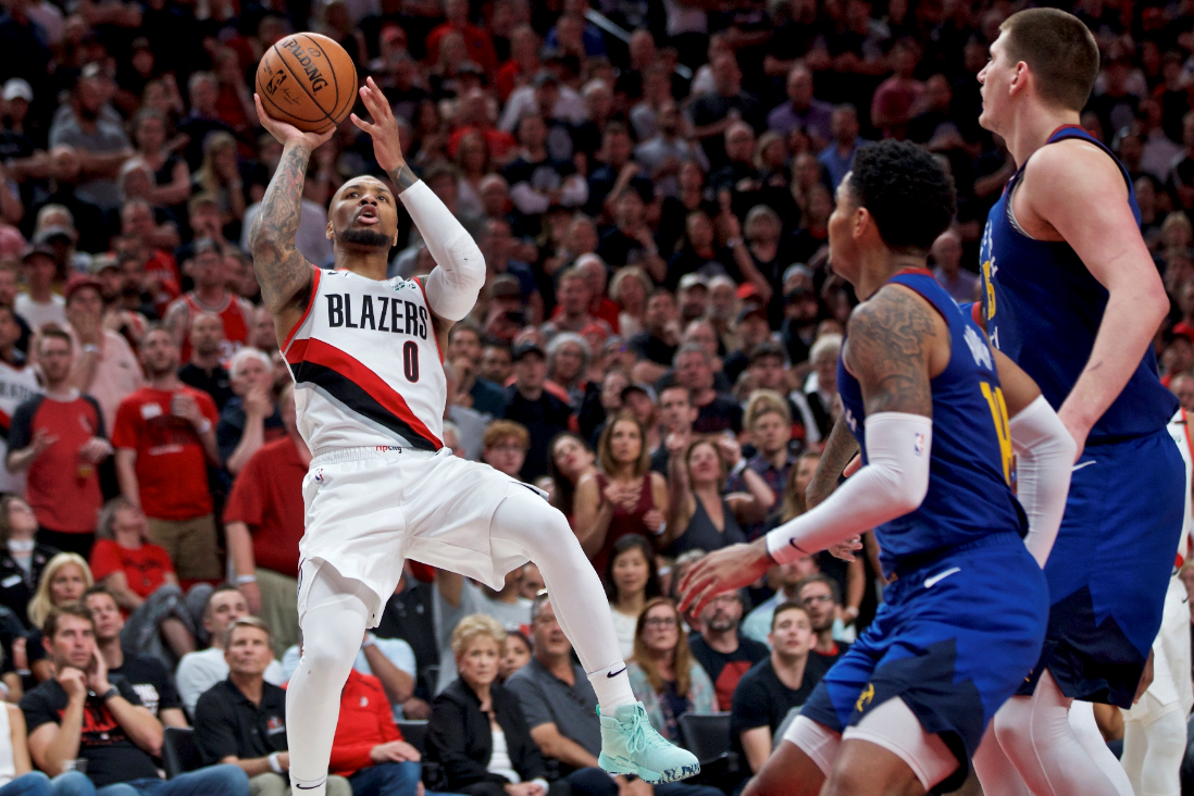 Portland Trail Blazers guard Damian Lillard, left, shoots over Denver Nuggets guard Gary Harris, center, and center Nikola Jokic, right, during the second half of Game 6 of an NBA basketball second-round playoff series Thursday, May 9, 2019, in Portland, Ore. The Trail Blazers won 119-108. (AP Photo/Craig Mitchelldyer)