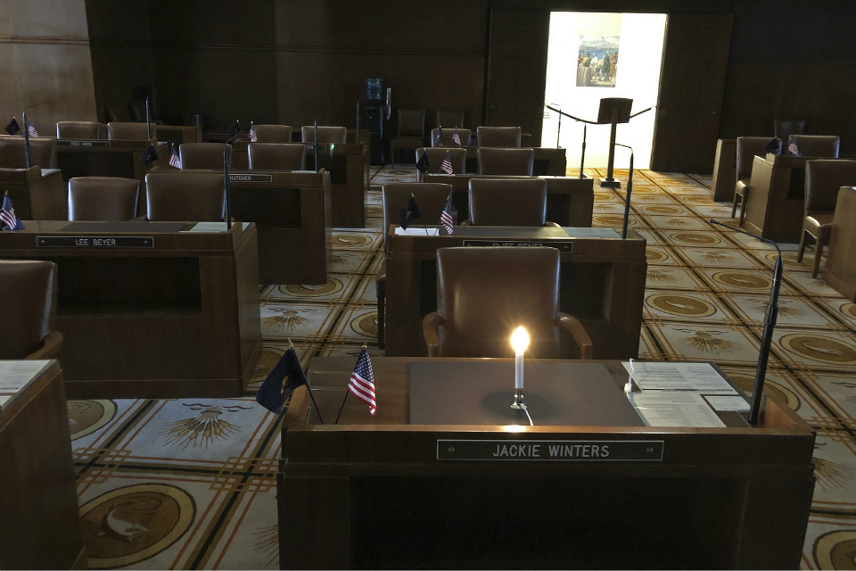 An electric candle lights up the desk of Oregon state Sen. Jackie Winters on Wednesday, May 29, 2019, in Salem, Ore., the day that the pioneering lawmaker died after a battle with lung cancer. Winters, the first African-American Republican elected to the Legislature, died on Wednesday. She was 82. House Speaker Tina Kotek made the announcement on the floor of the House of Representatives, and called for a minute of silence. (AP Photo/Andrew Selsky)