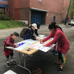 Supporters, including teachers and students, gathered at Jefferson High School Wednesday morning to make signs and prepare for the May 8 Day of Action to rally for education funding. Portland Public Schools closed for the rally, which drew an estimated 20,000 people to downtown Portland. (Photo by R. Dallon Adams)AAA