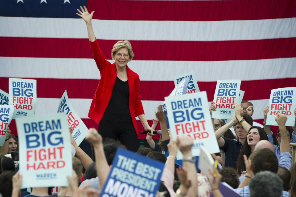 In this May 16, 2019, photo, Democratic presidential candidate Sen. Elizabeth Warren, D-Mass., addresses a campaign rally at George Mason University in Fairfax, Va. Warren is gaining traction with black women debating which Democratic presidential candidate to back in a historically diverse primary. (AP Photo/Cliff Owen)