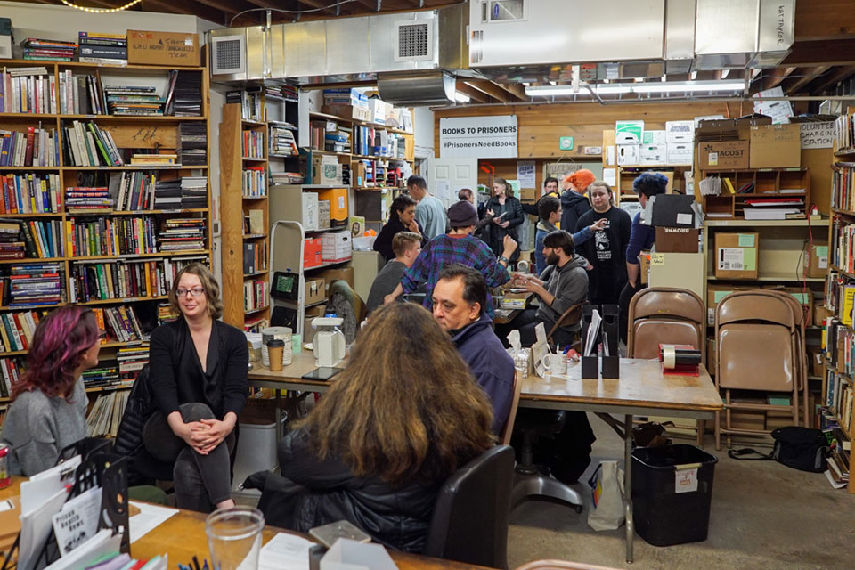 People gathered November 22 for an open house at the new location of Books to Prisoners in Seattle.