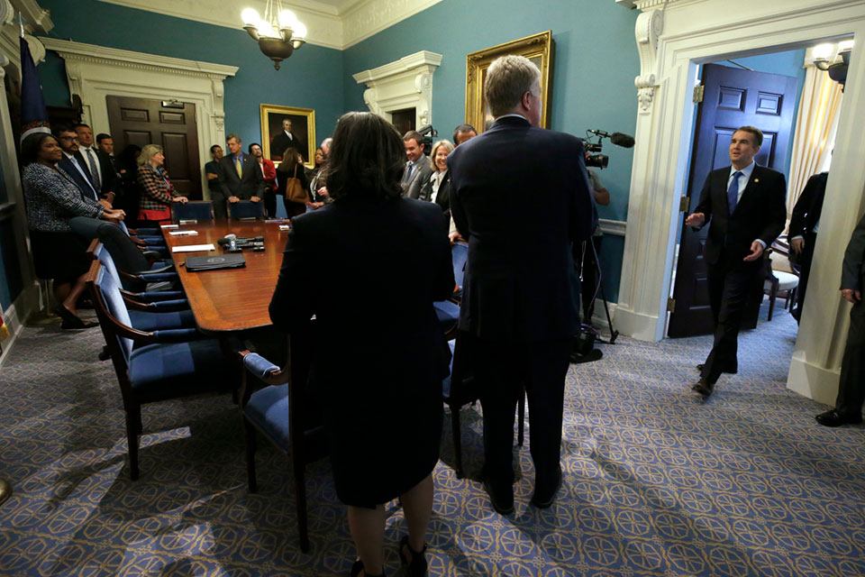 Virginia Governor Ralph Northam, right, enters a meeting of his Cabinet at the State Capitol in Richmond, Va., Wednesday, Nov. 6, 2019