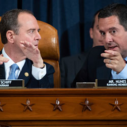 House Intelligence Committee Chairman Rep. Adam Schiff, D-Calif., left, talks with ranking member Rep. Devin Nunes, R-Calif.