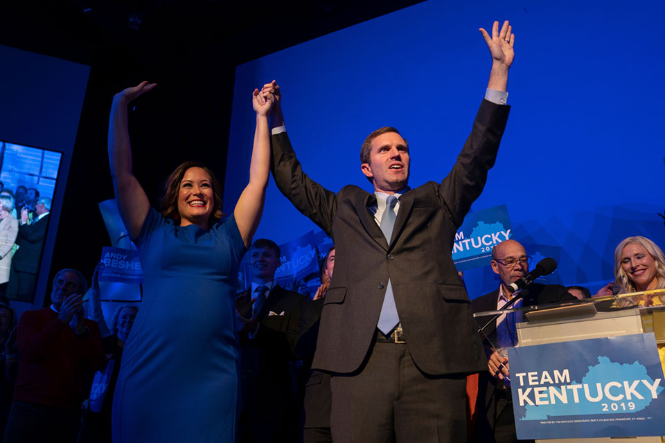 Democratic gubernatorial candidate and Kentucky Attorney General Andy Beshear, along with lieutenant governor candidate Jacqueline Coleman, acknowledge supporters at the Kentucky Democratic Party election night watch event, Tuesday, Nov. 5, 2019