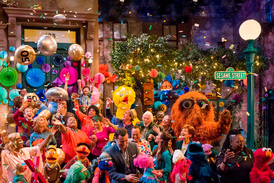 "This image released by HBO shows the cast of ""Sesame Street"" during a celebration of their 50th season of the popular children's TV show"