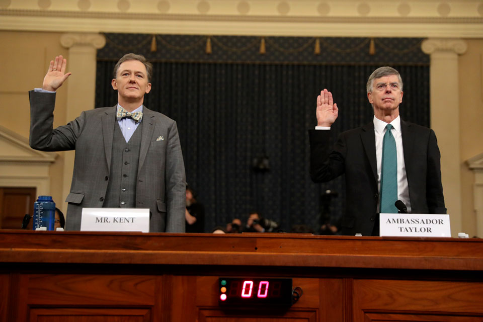 Career Foreign Service officer George Kent and top U.S. diplomat in Ukraine William Taylor, right, are sworn in to testify during the first public impeachment hearing of the House Intelligence Committee on Capitol Hill, Wednesday Nov. 13, 2019 in Washington