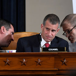 Ranking member Rep. Devin Nunes, R-Calif., talks to Rep. Jim Jordan, R-Ohio, right, as Steve Castor, Republican staff attorney for the House Oversight Committee, center, listens