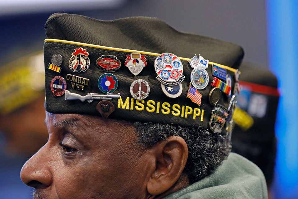 Harold Grant of Jackson, Miss, 71, an Army veteran, who served in Vietnam in 1968, wears his heavily decorated VFW garrison cap during an early Veteran's Day ceremony at the Museum of Mississippi History and Mississippi Civil Rights Museum in Jackson, Miss., Nov. 8, 2019