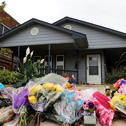 In this Oct. 15, 2019, photo, a makeshift memorial rests on the sidewalk that leads to the home of Atatiana Jefferson in Fort Worth, Texas.