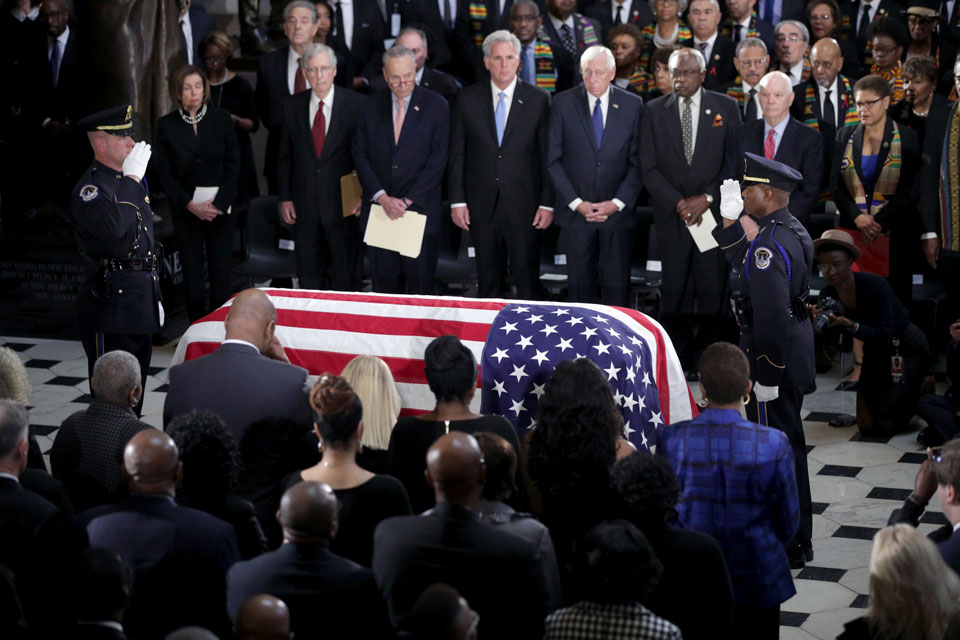 The flag-draped casket of Rep. Elijah Cummings, D-Md., lies in state at the Capitol, Thursday, Oct. 24, 2019 in Washington. (Alex Wong/Pool via AP)