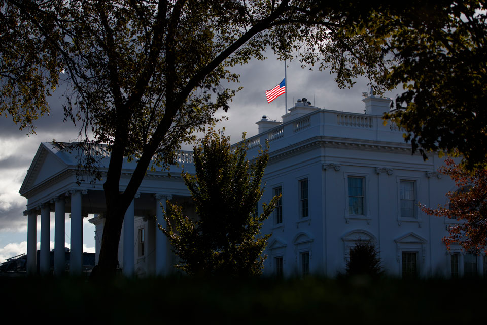 The flag above the White House flies at half-staff honoring Rep. Elijah Cummings, D-Md., who passed away, Thursday, Oct. 17, 2019, in Washington
