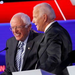 Democratic presidential candidate Sen. Bernie Sanders, I-Vt., left, and former Vice President Joe Biden hug during a Democratic presidential primary debate