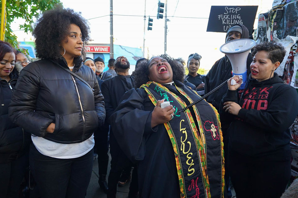 The Reverend Dr. Kelle Brown from Plymouth Church releases some pent up rage after speaking at a National Day of Outrage Rally, October 29 in front of the Seattle Police Department's East Precinct