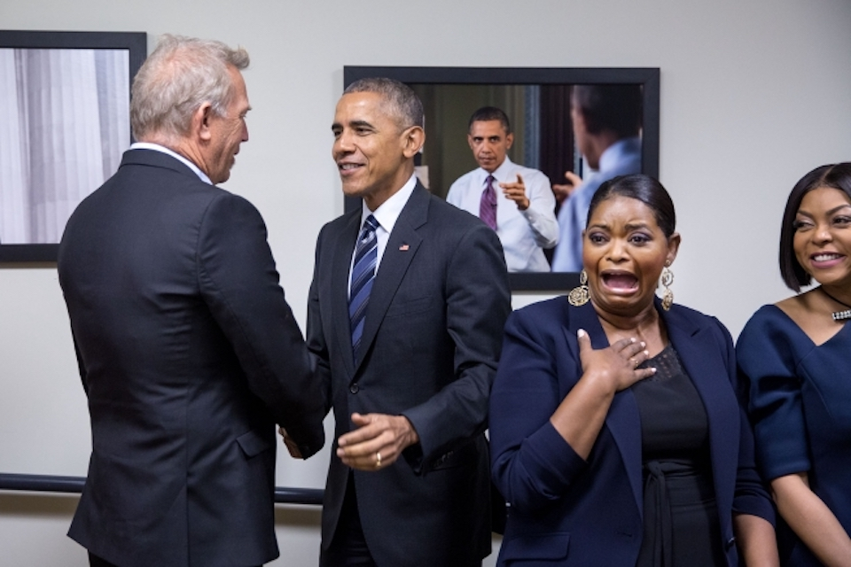 "Former President Barack Obama shakes hands with Kevin Costner after greeting Octavia Spencer and Taraji P. Henson during a surprise visit as then First Lady Michelle Obama met with the cast of the film ""Hidden Figures"" prior to a screening of the film in the Eisenhower Executive Office Building South Court Auditorium on Dec. 15, 2016. (Pete Souza)"