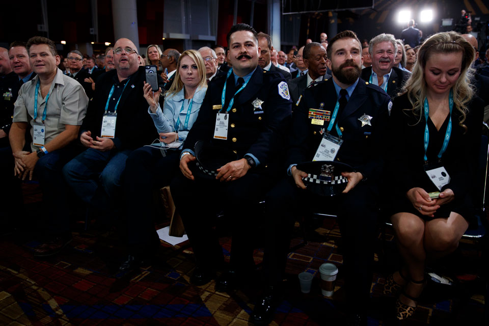 Audience members listen as President Donald Trump speaks during the International Association of Chiefs of Police Annual Conference and Exposition, at the McCormick Place Convention Center Chicago, Monday, Oct. 28, 2019, in Chicago. (AP Photo/Evan Vucci)